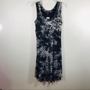 Sleeveless black and white leopard print dress.